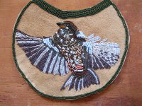 beaded bird on hide.