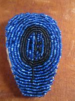 a second beaded necklace featuring petroglyth.